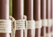 Rope knot around a metal fence Royalty Free Stock Photography