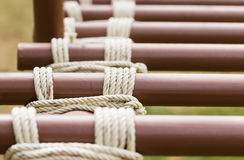 Rope knot around metal pipe Royalty Free Stock Images