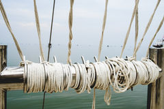 Rope knot on boat sea background Stock Photos
