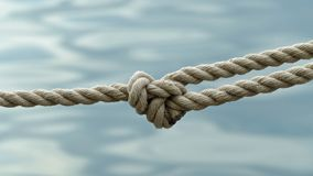 Rope Knot in front of the sea stock image