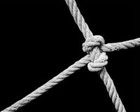 Rope knot isolated on black Stock Photos
