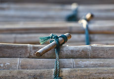 Rope knot. Old Rope knot with bamboo Royalty Free Stock Images