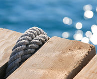 Rope knot on pier Royalty Free Stock Image