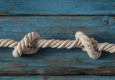 rope knot on wood Royalty Free Stock Photo