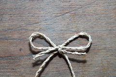 Rope Knot on Wooden table Royalty Free Stock Photos