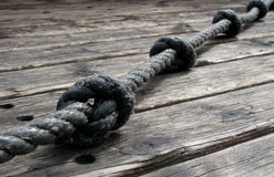 Rope & Knots. Old rope with knots on old wood boards Royalty Free Stock Photos