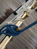 Rope Knots. A view of knots of ropes tied on a ship railing stock image