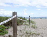 Rope leading to the beach Stock Image