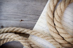 Rope and letter on dark wood Royalty Free Stock Photos
