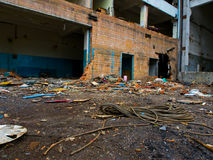 The rope lies on the background of a dilapidated building. Royalty Free Stock Photo