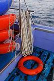 Rope, lifebuoy on sea boat. Rope, lifebuoy on boat in middle of sea Stock Photos