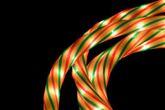 Rope lights alpha. Lit rope Christmas lights on a black background royalty free stock images