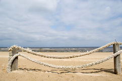 Rope log fence beach sand Royalty Free Stock Photos