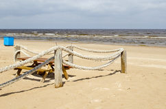 Rope log fence beach sand table bench waste bin Royalty Free Stock Photos