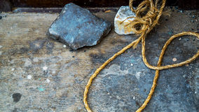 Rope loop stone on the ground Stock Photos