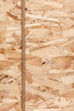 Rope lying on oriented strand board Royalty Free Stock Image