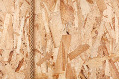 Rope lying on oriented strand board Stock Image