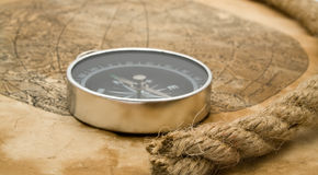 Rope, map and compass Stock Images