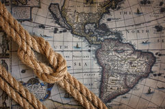Rope with marine knot and old map Royalty Free Stock Image
