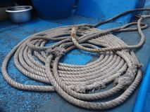 A rope. On a moored boat,detail of old weathered nautical rope Royalty Free Stock Photography