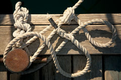 Rope for mooring. A vessel is adhered to a pier Royalty Free Stock Photos