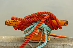 Rope Mooring Bollard. Mooring bollard with rope on pier by the sea royalty free stock images