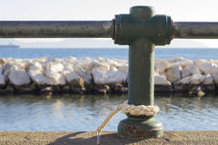 Rope mooring on sea Royalty Free Stock Photography