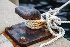 Rope for mooring a vessel is adhered to a pier Stock Photography