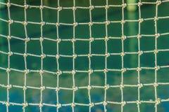 Rope nätverket med fnuren och kvadrera celler med bakgrund arkivfoto