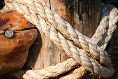 Rope, nail and wooden surface Stock Photos