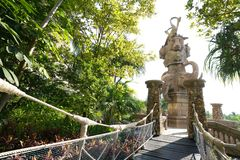 Rope net bridge and stone sculpture decorated royalty free stock photo