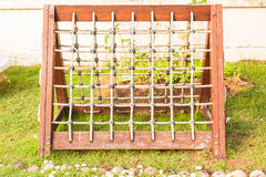 Rope net with wooden frame at playground for children climbing, local school Stock Photos