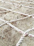 Rope network. Laces the net above the sand Stock Image