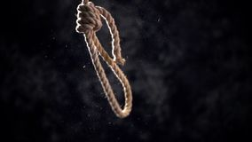 Rope noose with hangman knot in front of dark stock footage