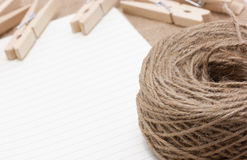 Rope on notebook with clothespin. Royalty Free Stock Images