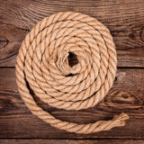 Rope on the old board Stock Images