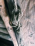 Rope on the old door. Old rope royalty free stock image