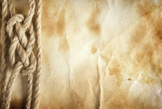 Rope on the old paper background Royalty Free Stock Image