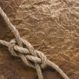 Rope on the old paper background Royalty Free Stock Photos
