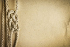 Rope on the old paper background Stock Image