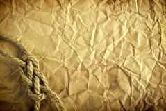 Rope on the old paper background Stock Photo