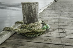 Rope on the old pier Stock Images