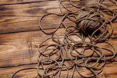 Rope on old wooden burned table or board for background Royalty Free Stock Photography