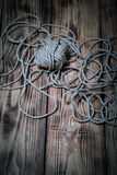 Rope on old wooden burned table or board for background. Toned Stock Image