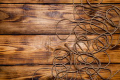 Rope on old wooden burned table or board for background. Toned Royalty Free Stock Photo
