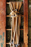 Rope on old the wooden ladder. Country background Royalty Free Stock Photo