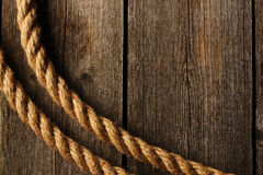 Rope over wooden background Royalty Free Stock Photos