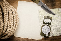 Rope, paper, map, compass and a knife Stock Photo