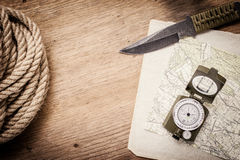 Rope, paper, map, compass and a knife Stock Images