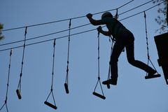 Rope park camping man climbing a rope stock images